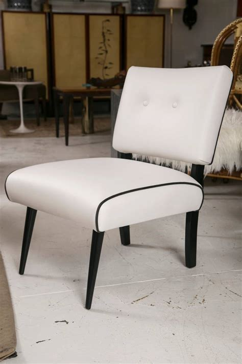 mid century modern slipper lounge chair in white vinyl for