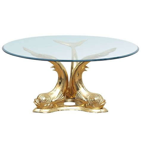 The base is made of marble and the glass top is beveled 1/2 thick tempered glass. Brass Dolphin Coffee Table For Sale at 1stdibs
