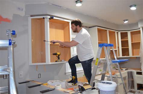 how to install upper cabinets kitchen renovation part 2 scott and ashleyscott and ashley
