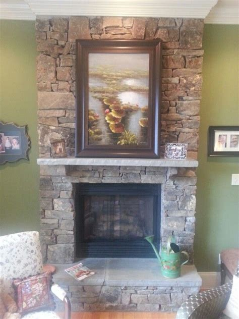 full height stone fireplace  raised hearth dont