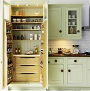 Dealing With Built In Kitchens For Small Spaces Spacious Kitchen Storage Storage Solutions