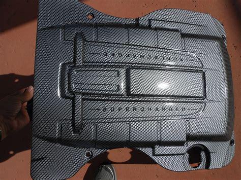 jaguar xkr  carbon fiber engine cover page  jaguar