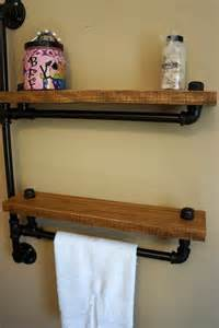 two tiered bathroom shelf with towel bar