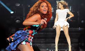 Beyonce is picture perfect in romper and fishnets as ...