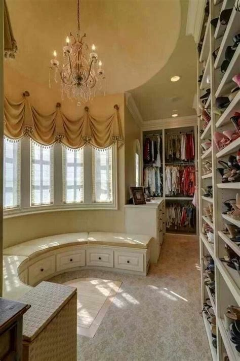 fancy walk in closet with circular lounge area 52