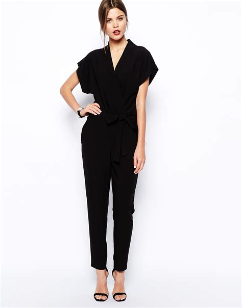 asos black jumpsuit asos jumpsuit with tie waist and sleeves in black lyst