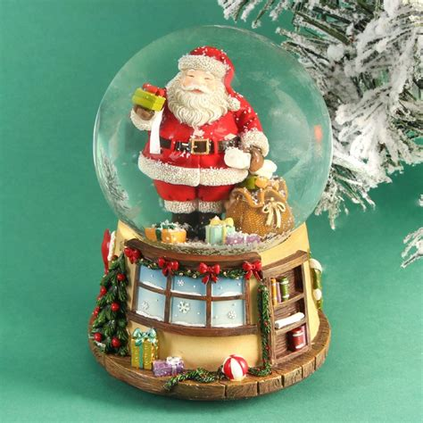 traditional christmas snowglobes traditional wind up snow globe with