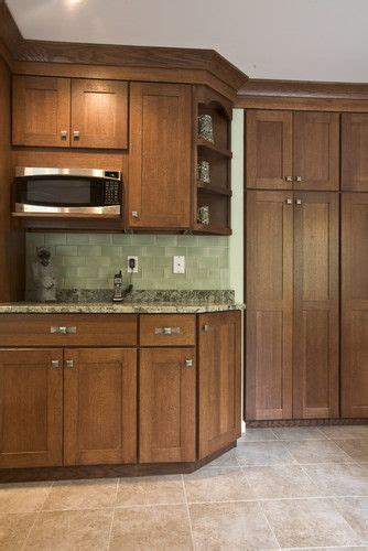 chestnut cabinets  light colored tile floors