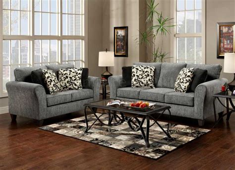 Black and gray living room furniture with cream wall