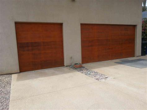 refinishing wood entry doors  garage doors peekbros
