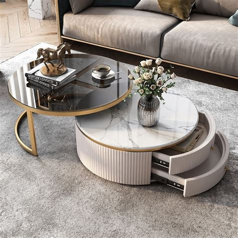 This coffee table can slide open for storage and be entirely used on top! Get 34+ Modern Round Coffee Table With Storage White Faux Marble Nesting Coffee Table With ...