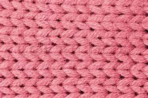 Pink knitted wool texture can use as background Stock