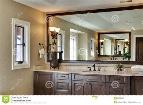 bathroom  large mirror stock photo image  window