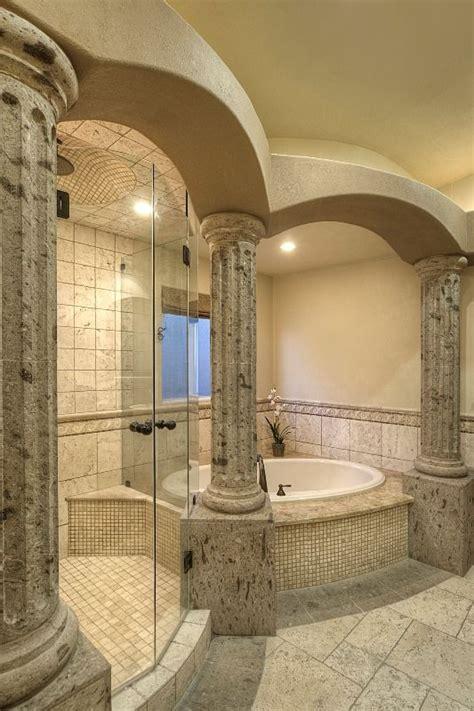 pin  allure designs   roman style master bathroom