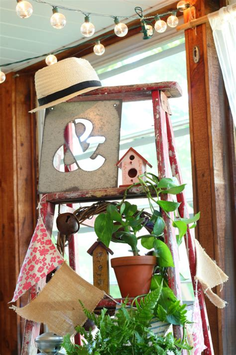 Decorating Ideas With Old Ladders by Old Ladders Repurposed For Decorating
