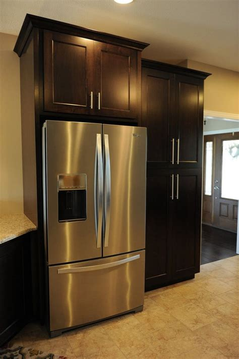 black polished oak wood tall  standing pantry cabinet