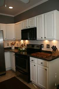 Paint oak cabinets white i don39t usually like white for Kitchen colors with white cabinets with where to find wall art