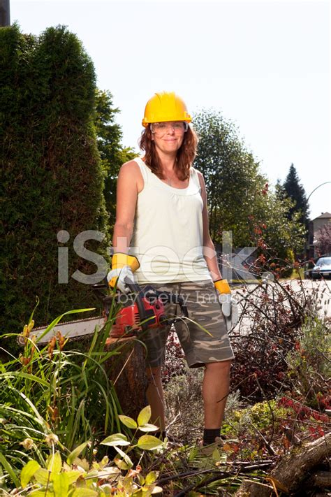 Real Flower Background Images Woman Outside With Chainsaw After Small Tree Is Cut Down Stock Photos Freeimages Com