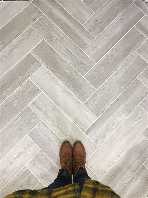 Lowes Bathroom Floor Tiles by Lowe S Vintage Gray Wood Look Tile In Herringbone Pattern