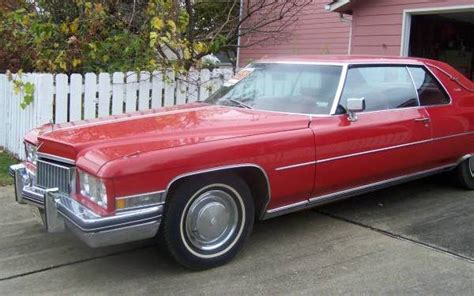 red  cadillac coupe deville