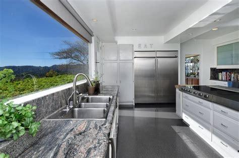 modern kitchen white cabinets terrazzo floors