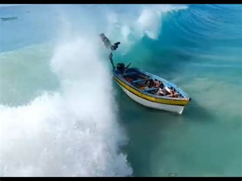 Small Boat Large Waves by Cape Verde Harbor Fishing Boat Is Capsized By A Big Wave