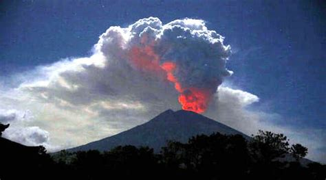 mount agung volcano erupts  indonesias bali disrupts aviation operations briefly adjoining