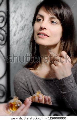 Seductive Brunette Girl Perfuming Herself By