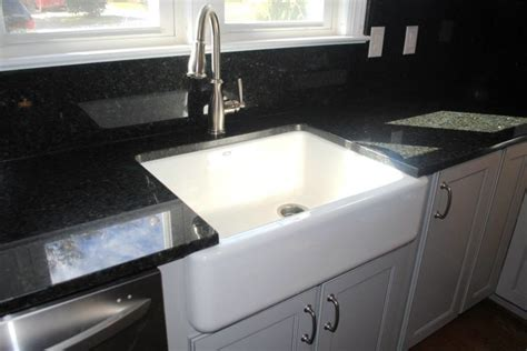 kohler whitehaven farmhouse sink accessories uba tuba granite and blackspash kohler whitehaven sink