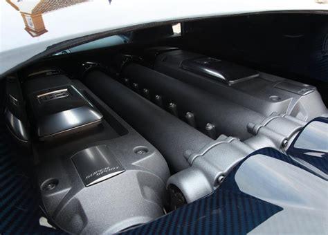 The super sport stops even quicker, exceeding 2.0 g in deceleration. 2011 Bugatti Veyron Super Sport engine