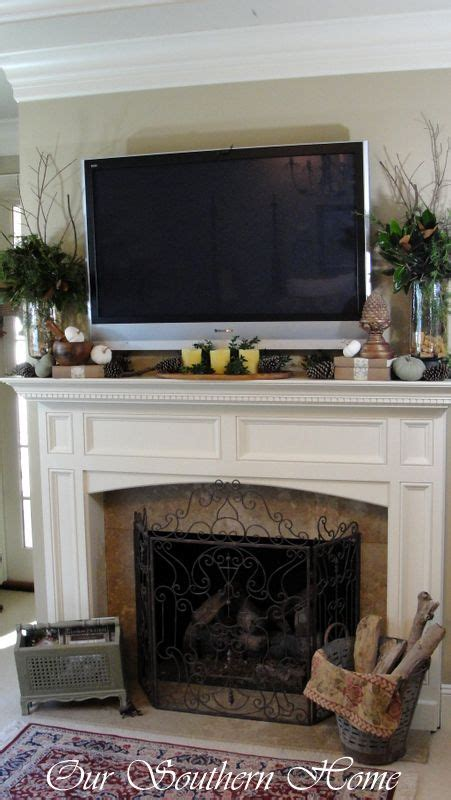 decorating fireplace mantel with tv above tv above mantle on porch ideas summer
