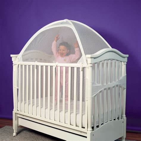 crib to toddler bed install a crib tent stop toddlers from climbing out of