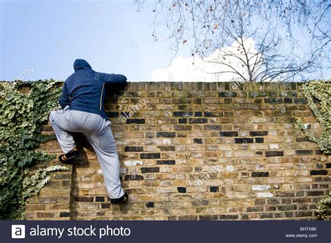 A Young Man Climbing Over A Wall Stock Photo 28206995  Alamy. Hotel Room With Own Pool. Childrens Bedroom Decor. Round Dining Room Table For 8. Decorative Moulding. Cheap Teen Decor. Cardinal Decorations. Beach Themed Bathroom Decorations. Black Dining Room Table Sets