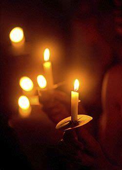 holding  candlelight vigil christmas eve candlelight