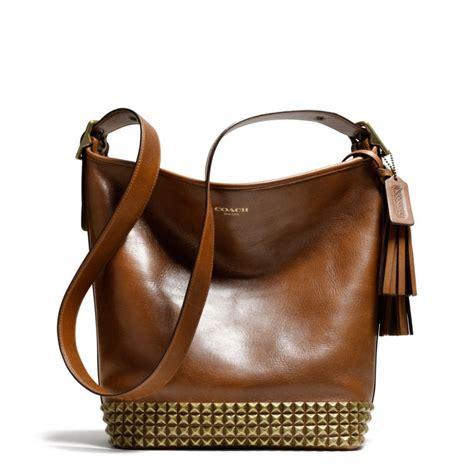 lyst coach legacy archival duffle  studded leather