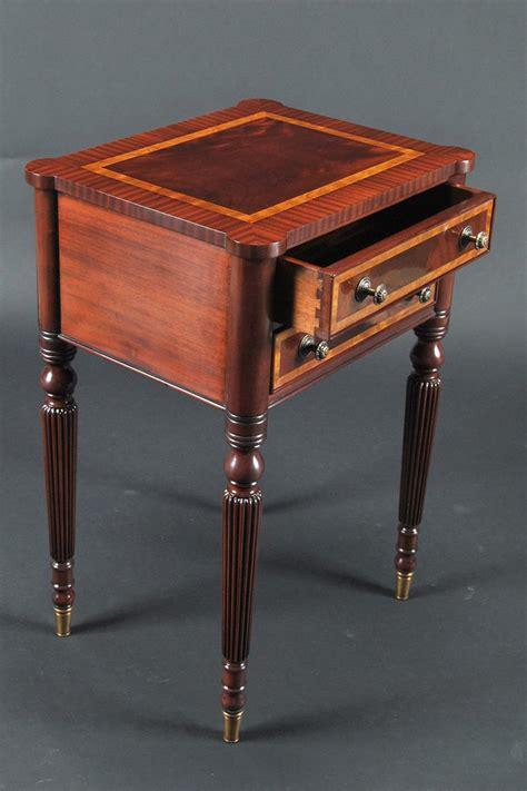 mahogany sheraton style accent table  brass feet