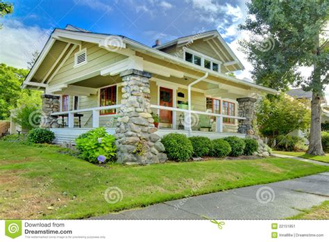 covered front porch  craftsman style home stock image