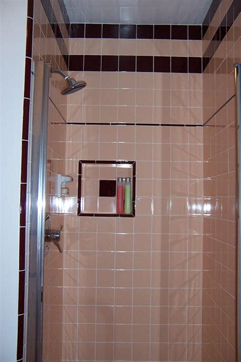 marsha saves  peach tile bathroom    bw
