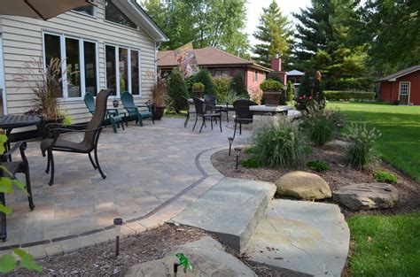 Patios & Decks : 4 Reasons To Replace Your Wooden Deck With A Paver Patio