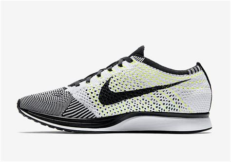 the nike flyknit racer in black white and volt has a