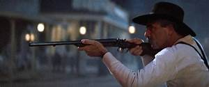 Morgan holds his shotgun on the Cowboys.