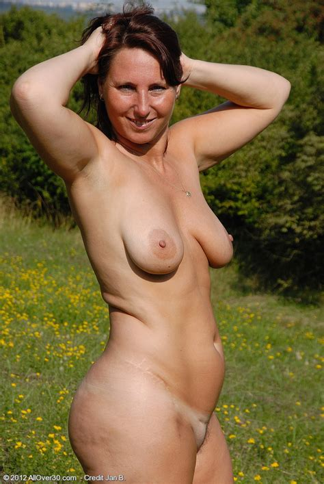 redhead milf demi strip naked at the outdoor moms archive
