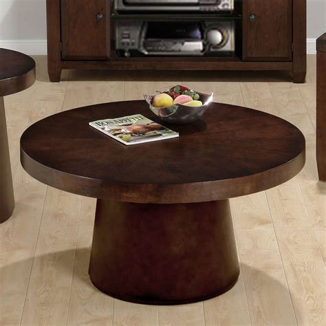 Smaller living spaces benefit from the storage shelf below, perfect for books, magazines, coasters and more. 18 Best Collection of Small Round Coffee Table Wood