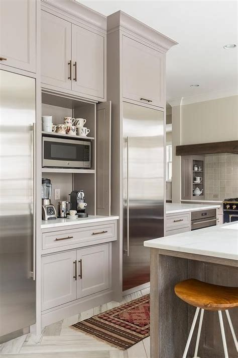 Coffee station with pocket doors. Great idea for