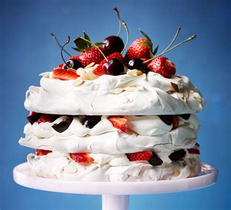 cuisine meringue amaretto meringue cake with strawberries cherries