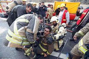 Firefighters killed as blazing building collapses in Iran ...
