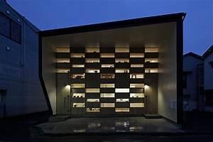 Small Japanese Home Exhibiting an Intriguing Wooden Facade