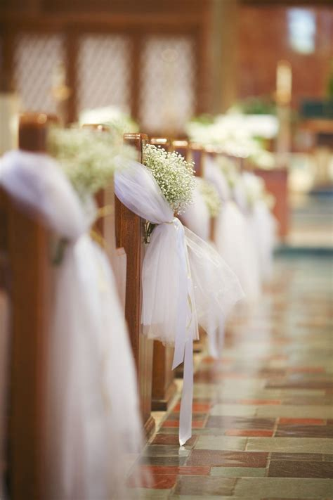 pew bows with tulle and baby s breath flowers by