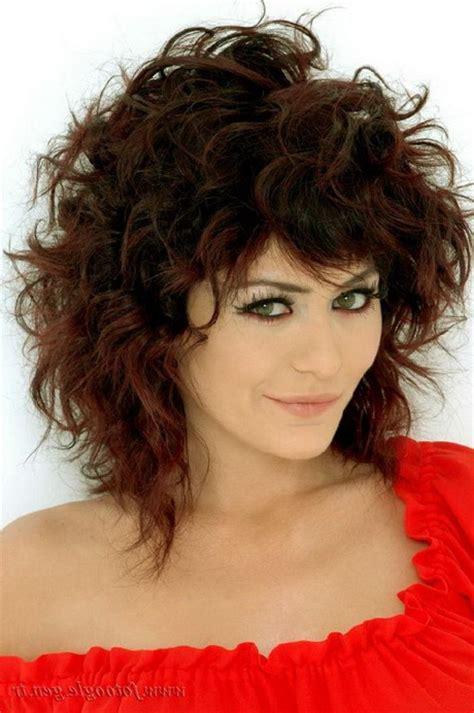 medium curly hairstyles with bangs medium length curly hairstyles with bangs