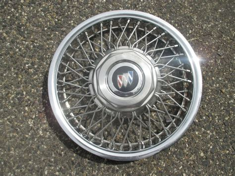 One Buick Century Locking Wire Spoke Hubcap